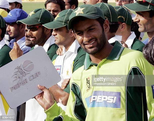 Pakistani cricket player Shoaib Malik celebrates after winning the Man of the match trophy as Pakistan won the sixmatch one day international series...