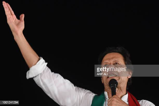 Pakistani cricket starturnedpolitician and head of the Pakistan TehreekeInsaf Imran Khan gives a speech during a political campaign rally for the...