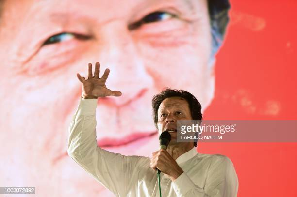 Pakistani cricket starturnedpolitician and head of the Pakistan TehreekeInsaf Imran Khan addresses a political campaign rally ahead of the general...