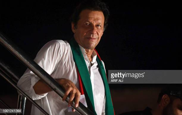Pakistani cricket starturnedpolitician and head of the Pakistan TehreekeInsaf Imran Khan looks on during a political campaign rally for the upcoming...