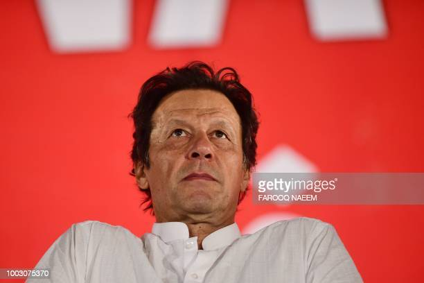 Pakistani cricket starturnedpolitician and head of the Pakistan TehreekeInsaf Imran Khan arrives to attend an election campaign rally ahead of the...