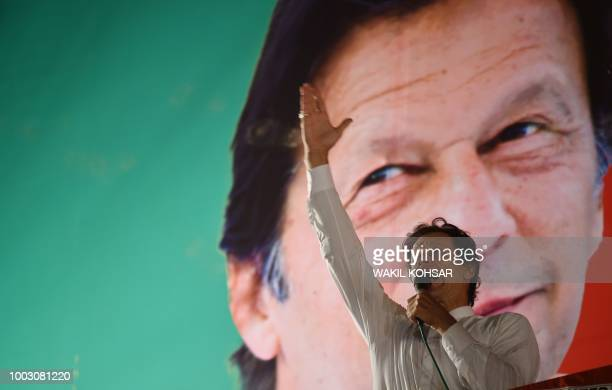 Pakistani cricket starturnedpolitician and head of the Pakistan TehreekeInsaf Imran Khan gestures as he delivers a speech during a political campaign...