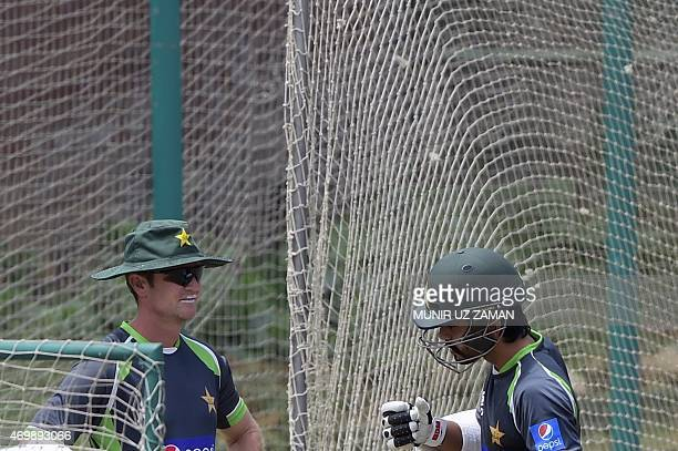 Pakistani cricket team batting coach Grant Flower talks to cricketer Fawad Alam during a practice session at the ShereBangla National Cricket Stadium...