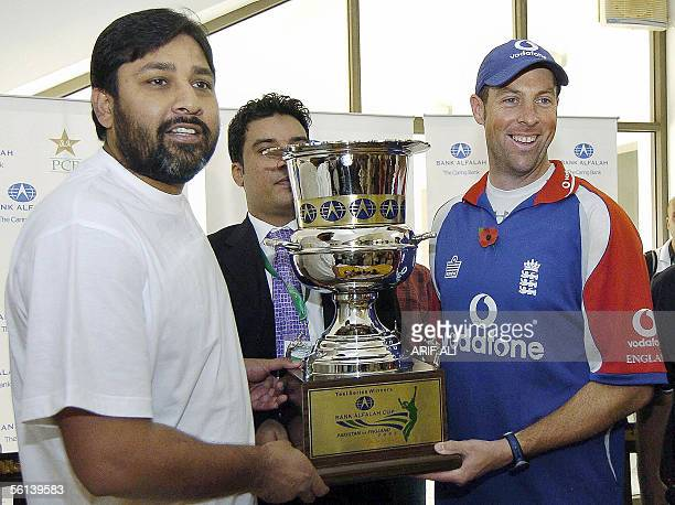 Pakistani cricket team captain Inzamamul Haq and England team captain Marcus Trescothick hold the Test series trophy during a ceremony in Multan...