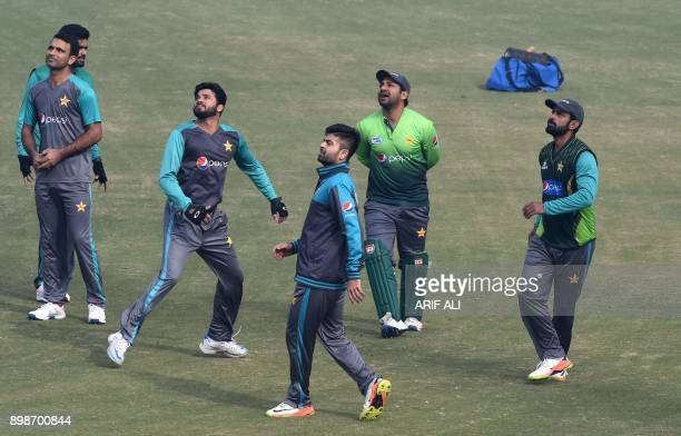 Pakistani cricket team captain Sarfraz Ahmed and teammates look on during a practice session in Lahore on December 26 2017 Pakistan still have...