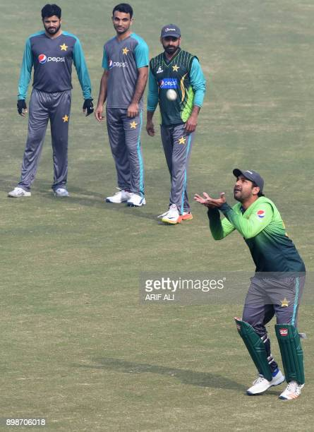 Pakistani cricket team captain Sarfraz Ahmed tries to catch a ball during a practice session in Lahore on December 26 2017 Pakistan still have...