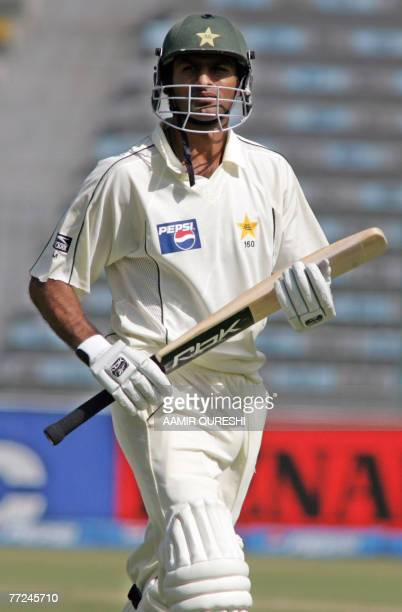 Pakistani cricket team captain Shoaib Malik walks back to pavilion after his dismissal during the third day of the second Test match between Pakistan...