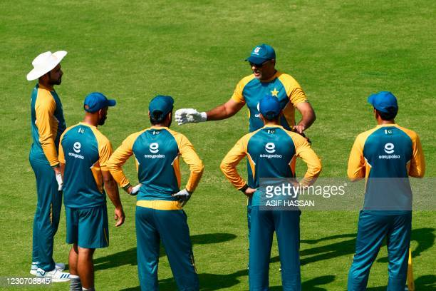 Pakistani cricket team coach Waqar Younis speaks with players during a practice session at theNational Stadiumin Karachi on January 21 in...