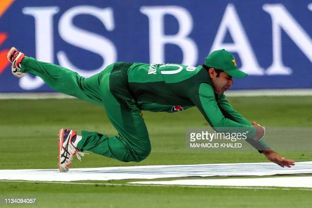 Pakistani cricketer Abid Ali catches the ball and dismisses Australian cricketer Shaun Marsh during the fifth one day international cricket match...