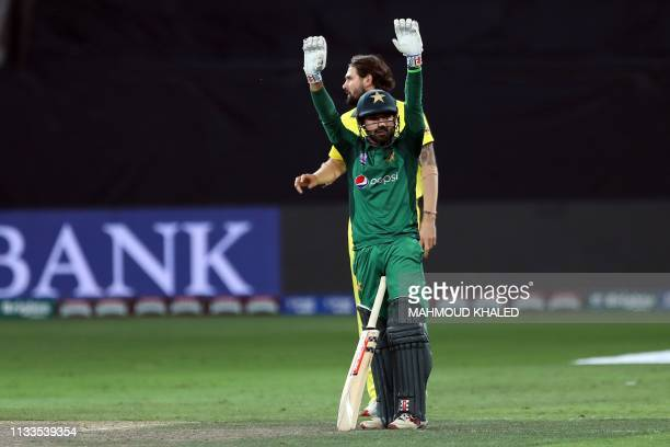 Pakistani cricketer Abid Ali celebrate his hundred on day international debut during the fourth one day international cricket match between Pakistan...