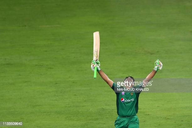 Pakistani cricketer Abid Ali celebrates his hundred on day international debut against Australia during the fourth one day international cricket...