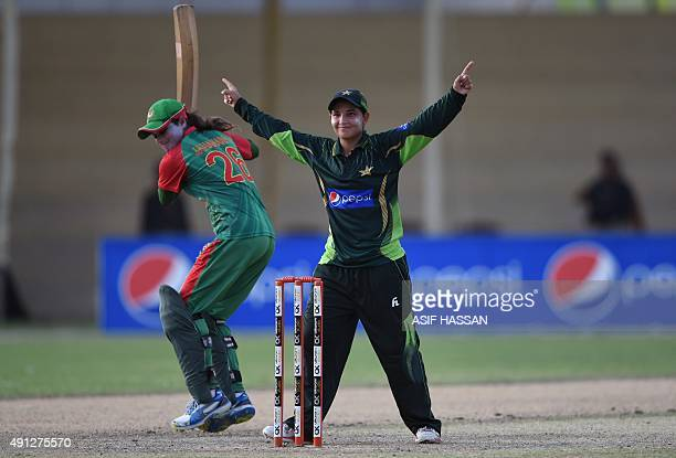 Pakistani cricketer Anam Amin celebrates after taking wicket of Bangladeshi cricketer Jahanara Alam during the first women's One Day International...