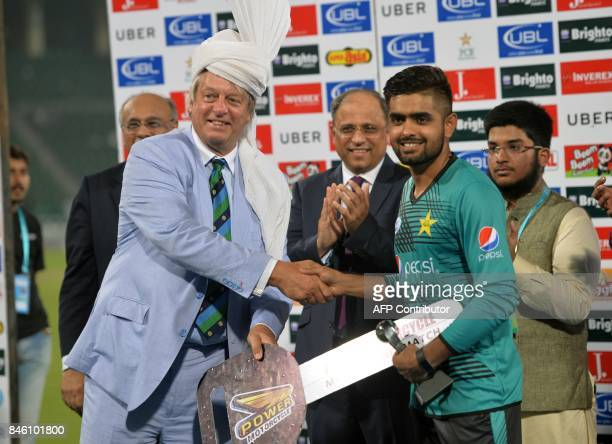 Pakistani cricketer Babar Azam receives man of the match award from Director of the International Cricket Council Giles Clarke during a ceremony at...