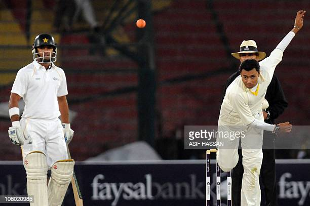Pakistani cricketer Danish Kaneria delivers a orange ball in the domestic final of the QuaideAzam trophy match at the National Stadium in Karachi on...