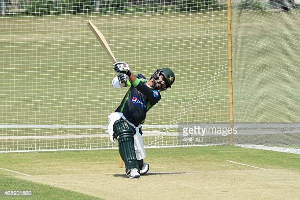 Pakistani cricketer Fawad Alam plays a shot during a training camp for the upcoming Bangladesh cricket tour at the Gaddafi Stadium in Lahore on April...