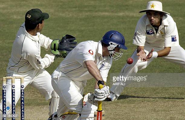 Pakistani cricketer Hasan Raza successfully catches the ball off England batsman Andrew Strauss during the fifth and last day of the first Test match...
