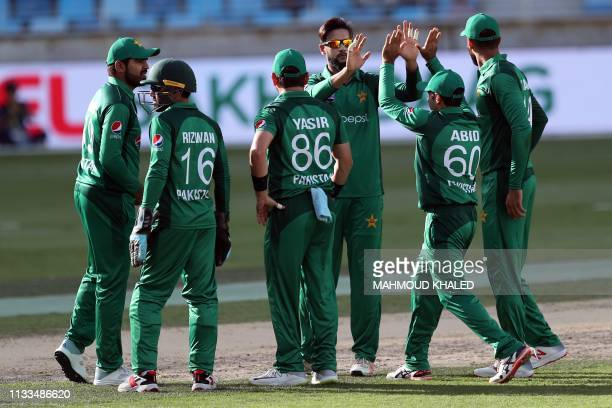 Pakistani cricketer Imad Wasim celebrates the dismissal of Australian cricketers Peter Handscomb during the fourth one day international cricket...