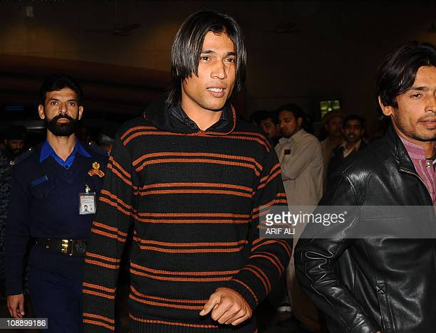 Pakistani cricketer Mohammad Aamer arrives from Doha at the Allama Iqbal International airport in Lahore early February 8 2011 The head of the...