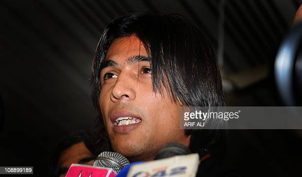Pakistani cricketer Mohammad Aamer talks to media at the Allama Iqbal International airport upon his arrival from Doha in Lahore early February 8...
