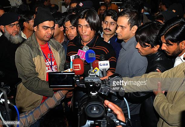Pakistani cricketer Mohammad Aamer talks to the media at the Allama Iqbal International airport upon his arrival from Doha in Lahore early February 8...