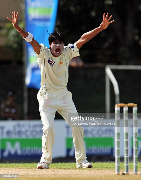 Pakistani cricketer Mohammad Aamer unsuccessfully appeals for a Leg Before Wicket decision against unseen Sri Lankan cricketer Tharanga Paranavitana...