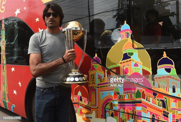 Pakistani cricketer Mohammad Irfan holds the 2019 ICC Cricket World Cup trophy during an event in Lahore on October 3 2018 The 2019 Cricket World Cup...