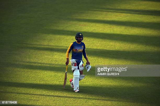 Pakistani cricketer Mohammad Nawaz leaves the pitch after a practice session at the Sharjah Cricket Stadium in Sharjah on October 28 ahead of their...
