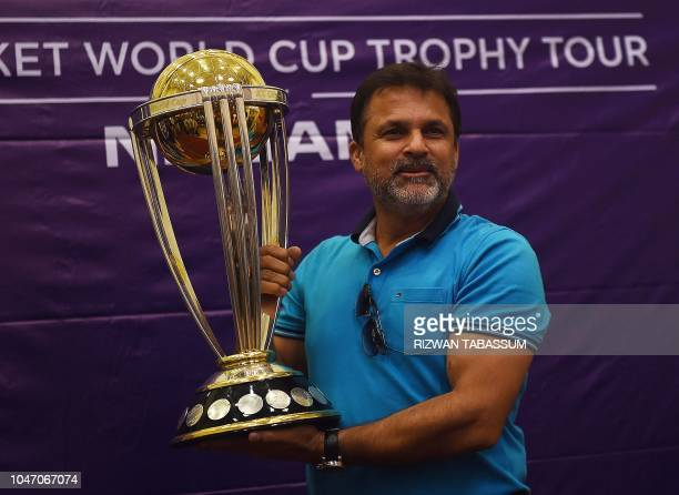Pakistani cricketer Moin Khan holds the 2019 ICC Cricket World Cup trophy during a country tour event in Karachi on October 7 2018 The 2019 Cricket...
