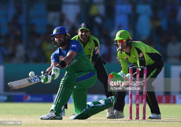 Pakistani cricketer of Multan Sultans Shahid Afridi plays a shot during the third match between the Lahore Qalandars and Multan Sultans of the last...