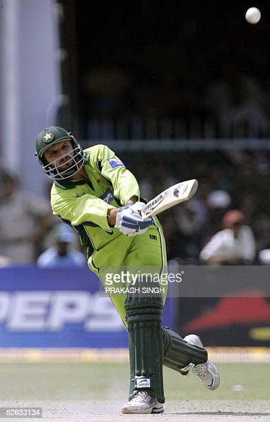 Pakistani cricketer Shahid Afridi hits a ball for six during the fifth one day international cricket match between India and Pakistan at The Green...