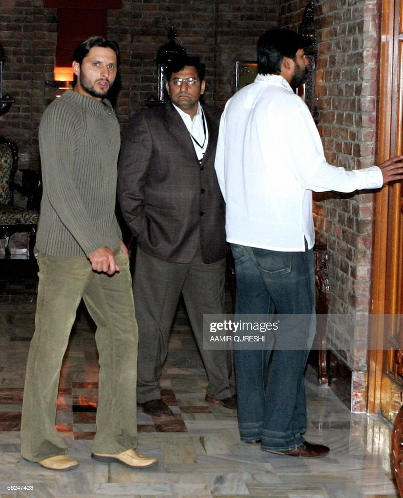 Pakistani cricketer Shahid Afridi (L) is accompanied by captain Inzamam-ul-Haq, (R) as he leaves a hearing with match referee Roshan Mahanama (unseen) in Faisalabad, 21 November 2005. Afridi was summonsed after he was alleged to have affected the pitch at Iqbal Cricket Stadium during the second Test against England. The International Cricket Council (ICC) is to make an announcement on the hearing later on 21 November. AFP PHOTO/ Aamir QURESHI