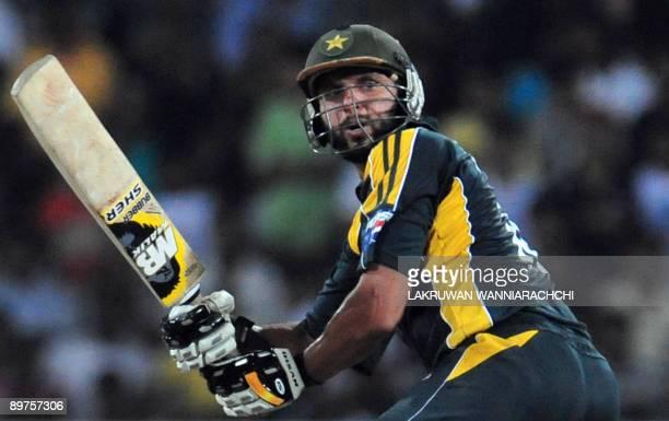 Pakistani cricketer Shahid Afridi plays a shot during a Twenty20 match between Sri Lanka and Pakistan at The R. Premadasa Stadium in Colombo on...