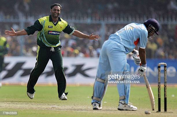 Pakistani cricketer Shoaib Akhtar celebrates after taking the wicket of Indian captain Mahendra Singh Dhoni during their third Oneday International...