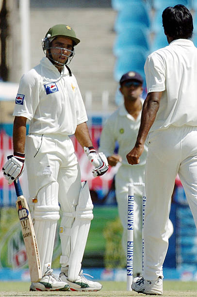 Pakistani cricketer Taufiq Umer looks at Indian bowler Laxmipathy Balaji after being dismissed during the first day of the third and final Test match.