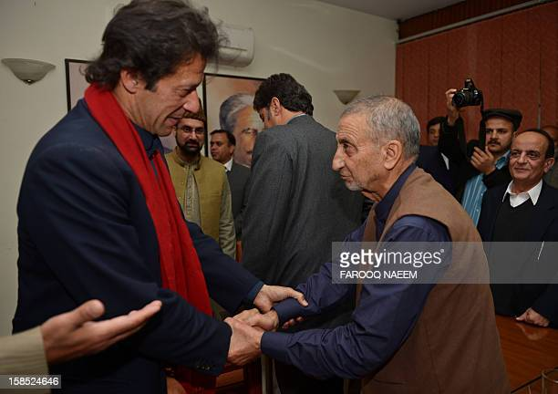 Pakistani cricketer turned politician Imran Khan greets leaders of the moderate All Parties Hurriyat Conference Abdul Ghani Bhatt and Mirwaiz Umar...