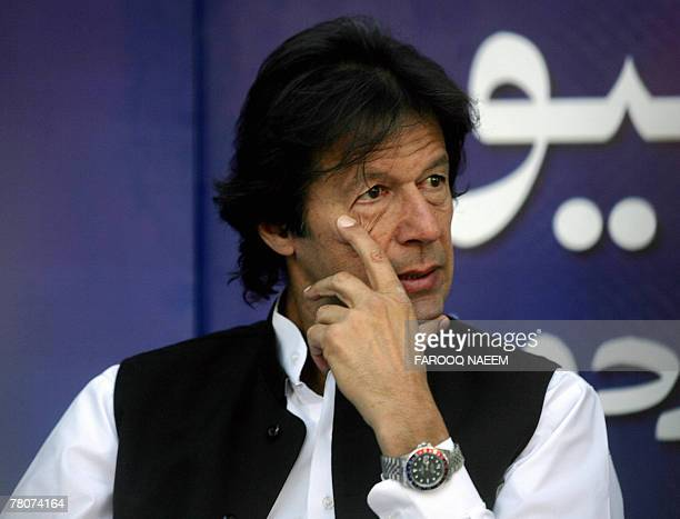 Pakistani cricketer turned politician Imran Khan sits in an open air program of banned Geo television channel in Islamabad, 23 November 2007....