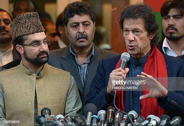 Pakistani cricketer turned politician Imran Khan talks with media representatives along with leaders of the moderate All Parties Hurriyat Conference...