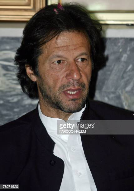 Pakistani cricketer turned politician Imran Khan talks with party leaders during a meeting following his release from jail, in Islamabad, 22 November...