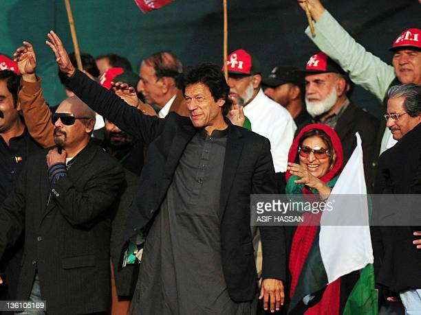 Pakistani cricketer turned politician Imran Khan waves to the crowd during a public meeting in Karachi on December 25, 2011. As Pakistan wrestles...