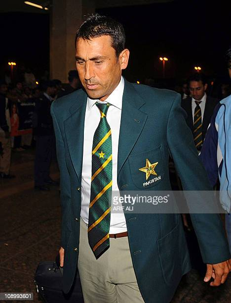 Pakistani cricketer Younis Khan arrives at the Allama Iqbal International airport in Lahore early on February 11 2011 on the way to Dhaka to play...
