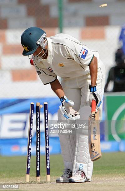 Pakistani cricketer Younus Khan looks at the shattered stumps during the fifth and final day of the first Test match between Pakistan and Sri Lanka...