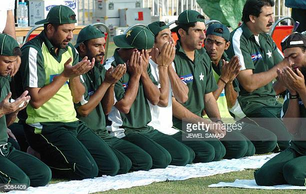 Pakistani cricketers offer prayers during a practice session at the Rawalpindi Stadium in Rawalpindi 14 March 2004 Indian coach Wright said he was...