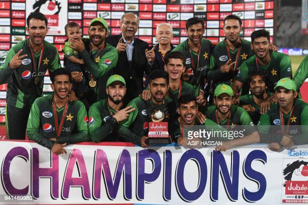 Pakistani cricketers pose with the trophy after victory in the third and final Twenty20 international cricket match between Pakistan and West Indies...