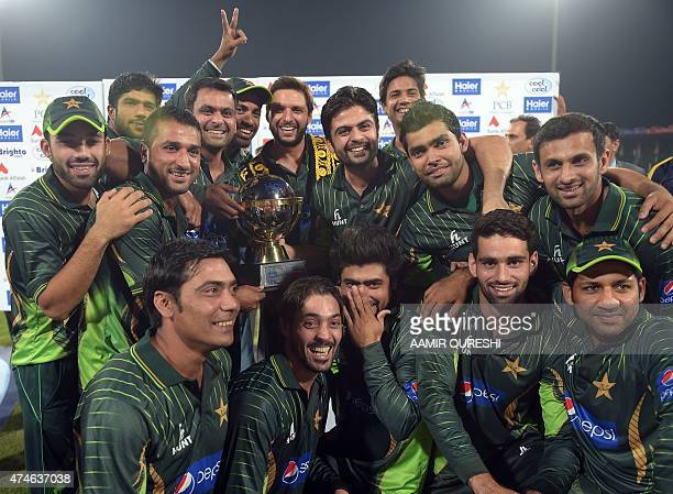 Pakistani cricketers pose with the winning trophy after defeating Zimbabwe at the end of the second and final International T20 cricket match between...