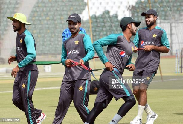 Pakistani cricketers Shadab Khan , Faheem Ashraf , Mohammad Amir , and Hasan Ali take part in a practice session during a training camp for the...