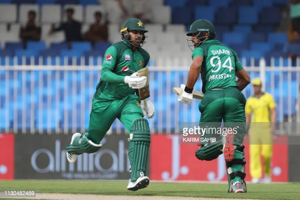 Pakistani cricketers Shan Masood and Haris Sohail run between the wickets during the second one day international cricket match between Pakistan and...