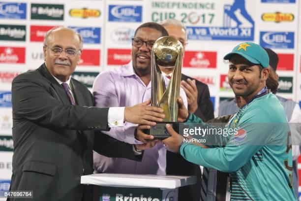 Pakistani cricketers skipper Sarfraz receiving trophy from Chairman Pakistan Cricket board Najam Sethi after winning the Twenty20 International match...