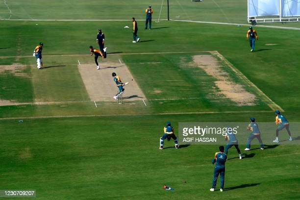 Pakistani cricketers take part of team during a practice session at theNational Stadiumin Karachi on January 21 in preparation for the first Test...