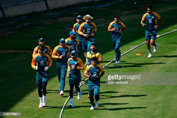 Pakistani cricketers warm up before a practice session at theNational Stadiumin Karachi on January 21 in preparation for the first Test match...