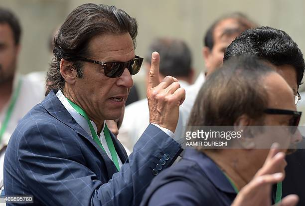 Pakistani cricketerturned politician and head of the Pakistan Tehreek e Insaaf party Imran Khan gestures as he arrives at the Supreme Court to attend...